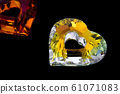 gemstone in the shape of heart on black background 61071083