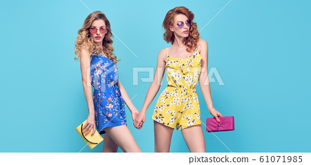 Two Adorable fashion woman, stylish summer outfit 61071985