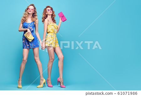 Two Adorable fashion woman, stylish summer outfit 61071986