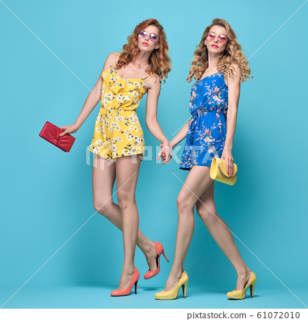 Two fashion woman stylish summer outfit, hairstyle 61072010