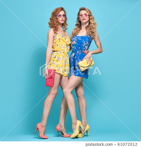 Two Adorable fashion woman, stylish summer outfit 61072012