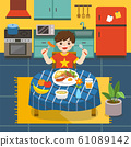 Adorable little Boy have breakfast in the kitchen. 61089142