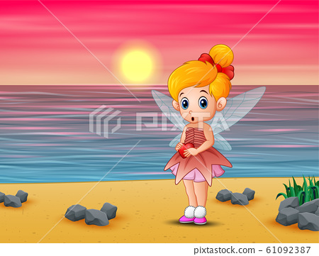 Cute little love fairy standing on the beach 61092387