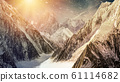 High mountains with falling snow 61114682