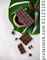 Dark chocolate with cocoa 61123165