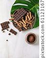 Dark chocolate with cocoa 61123167