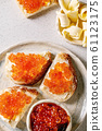 Red caviar with bread and butter 61123175
