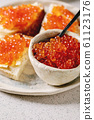 Red caviar with bread and butter 61123176