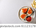 Red caviar with bread and butter 61123178