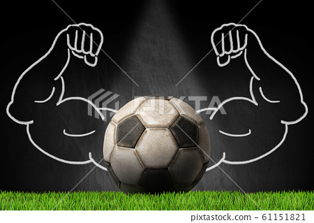 Old soccer ball on a blackboard with muscular arms 61151821