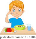 Cartoon little boy having breakfast cereals with fruits 61152106