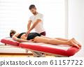 Osteopath doing paravertebral treatment 61157722