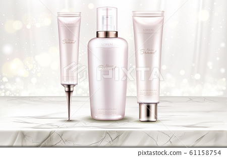Beauty cosmetics bottles line on marble table top 61158754