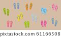 many colorful flip flops on sandy beach 61166508