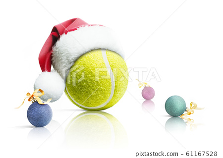 Christmas tennis. Tennis ball in Santa hat Christmas toys on white background. Isolated 61167528