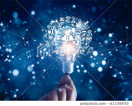 .Hand holding light bulb and business digital marketing innovation technology icons on network connection, blue background 61186650