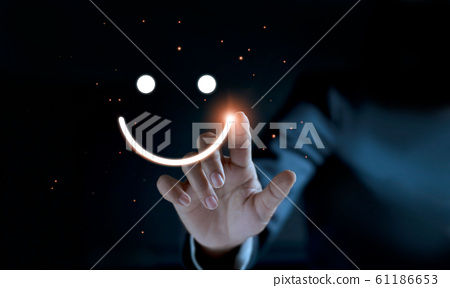 Finger of businessman touching and drawing face emoticon smile on dark background, service mind, service rating. Satisfaction and  customer service concept. 61186653