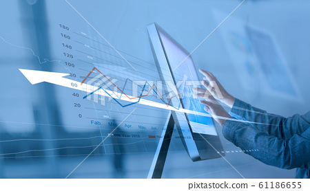 Businessman analyzing sales data on computer networking, Abstract interface, and economic growth graph chart with social network diagram, digital marketing. 61186655