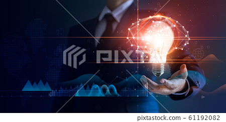 Businessman holding light bulb and brain network with icon business and technology, innovative in futuristic, network connection on virtual interface background, abstract, innovation and business tech 61192082