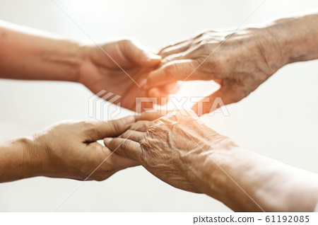 Close up hands of helping hands elderly home care.Mother and daughter. Mental health and elderly care concept 61192085