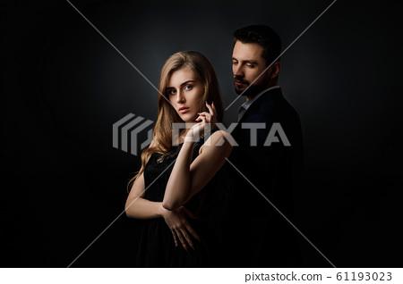 elegant couple on black background. 61193023
