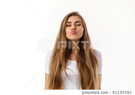 Cute young woman sending kiss 61193392