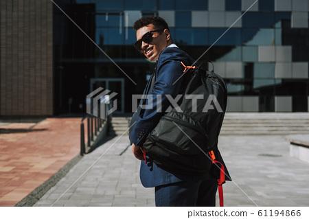 Joyful exacutive carrying backpack to office stock photo 61194866