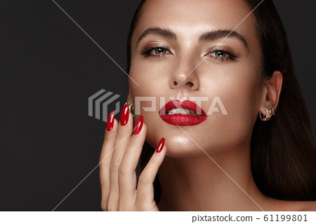 Beautiful girl with a classic make-up and red nails. Manicure design. Beauty face. 61199801