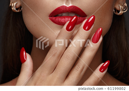 Beautiful girl with a classic make-up and red nails. Manicure design. Beauty face. 61199802