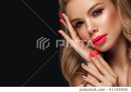 Beautiful young woman with bright makeup and neon pink nails. Beauty face. 61199908