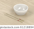 Empty bowl and wooden chopsticks 61218894