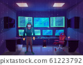Hacker in server room, multiple computer monitors 61223792