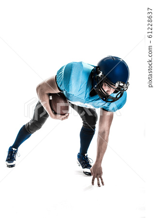 American Football Player with blue uniform on the scrimmage line. White background 61228637