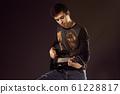 Handsome man playing electro guitar, studio shot 61228817
