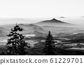 Ralsko Mountain rising from the mist. Weather temperature inversion in Central Bohemian Uplands, Czech Republic 61229701