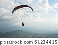colorful paragliding over blue sky at town 61234415