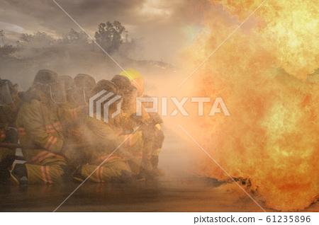 Fireman fighting a bush fire in Australia forest 61235896