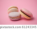 Closeup of french macarons on pink background 61243345
