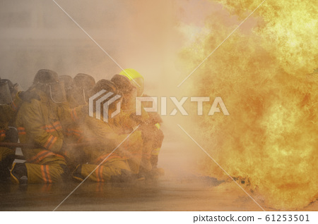 fireman fighting fire flame with water and extinguisher in training workshop 61253501