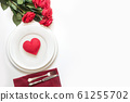 Table setting with red heart and bouquet of red roses. View from above. Valentine day. 61255702