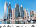 Dubai Marina Canal, skyscrapers and luxury yachts 61256507