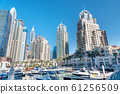 Dubai Marina Canal, skyscrapers and luxury yachts 61256509