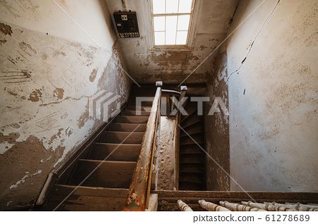 Old staircase in abandoned house filled with sand, Kolmanskop Ghost Town 61278689