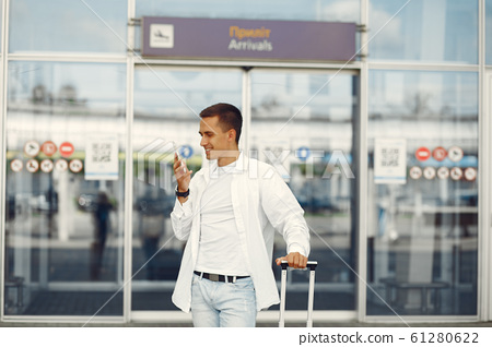 Handsome man standing near the airport 61280622