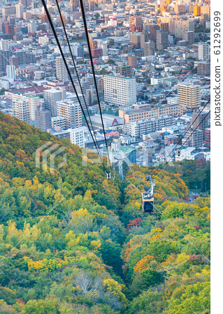 Cable car over mountain and city central 61292699