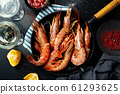 Uncooked giant shrimps on dark table 61293625