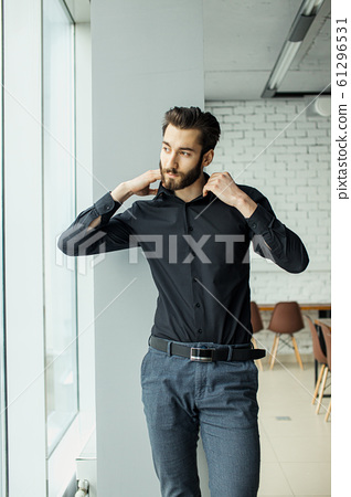 portrait of handsome man in office 61296531