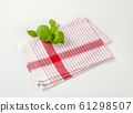 Tea towel and basil leaves 61298507