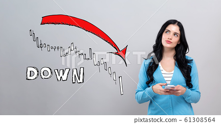 Market down trend chart with woman holding a smartphone 61308564