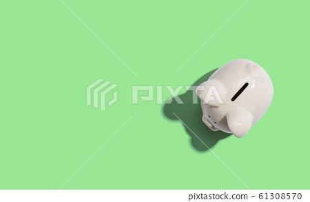 A white piggy bank overhead view 61308570